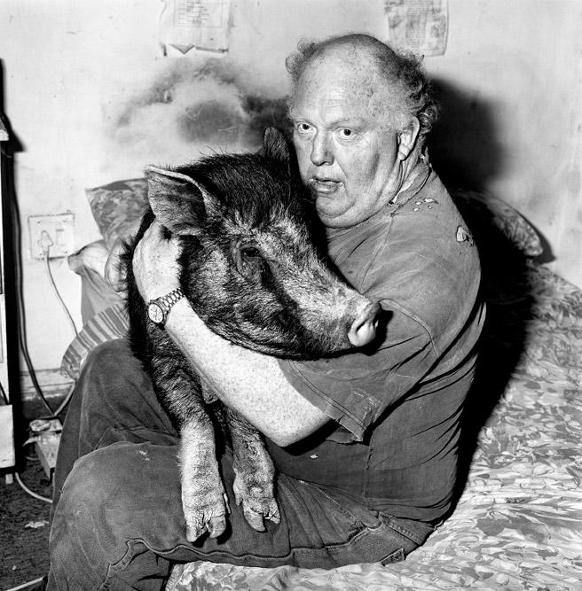 Roger Ballen: Brian with pet pig, 1998.